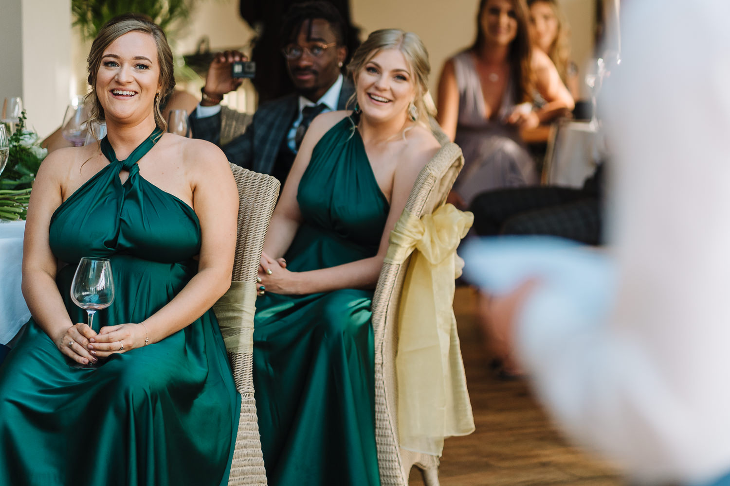 bridesmaids laughing during speeches