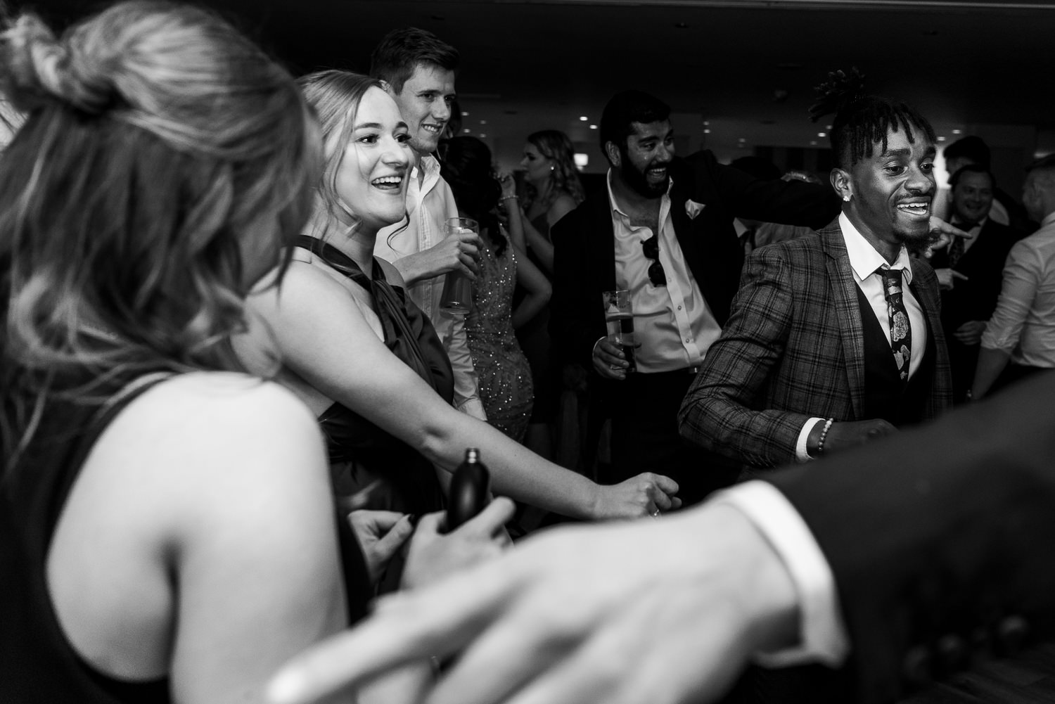 guests dancing and drinking at Mitton Hall