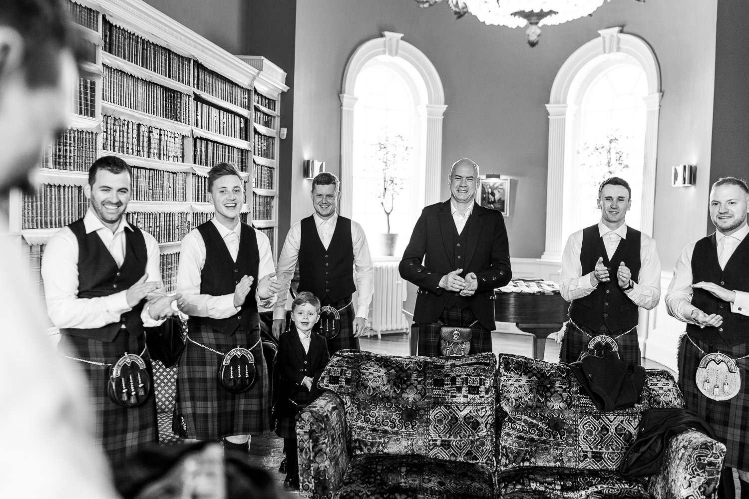 Groomsmen having a whiskey in Iscoyd Parks Library