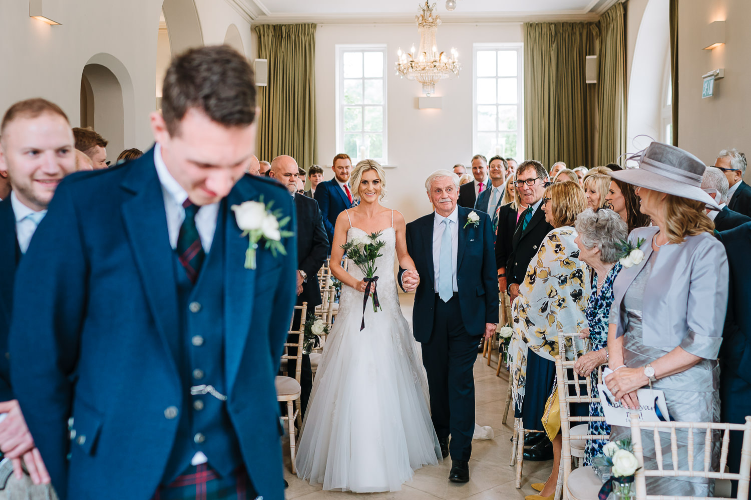 Bride and her dad walking down the aisle at Iscoyd Park