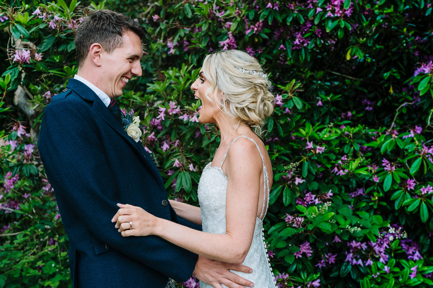 Bride and groom laughing during couples portraits