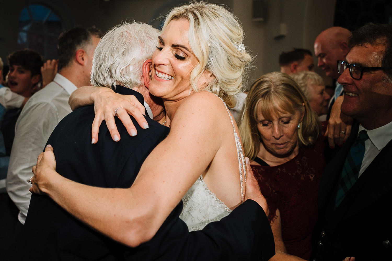 Bride hugging her dad on the dance floor