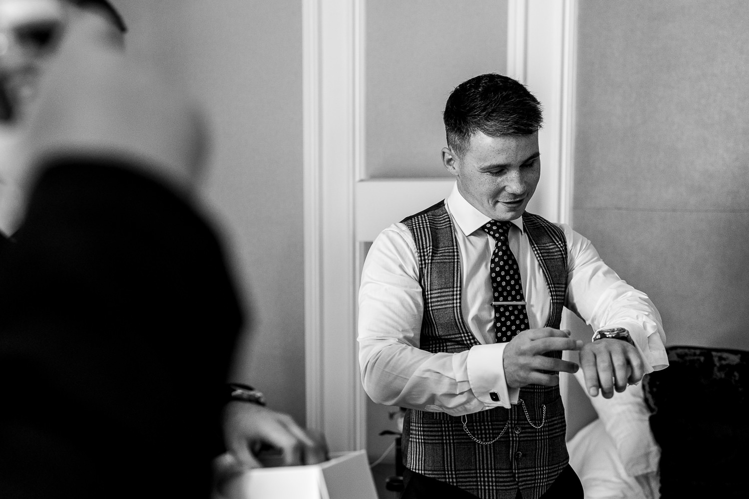 Groom trying on his watch