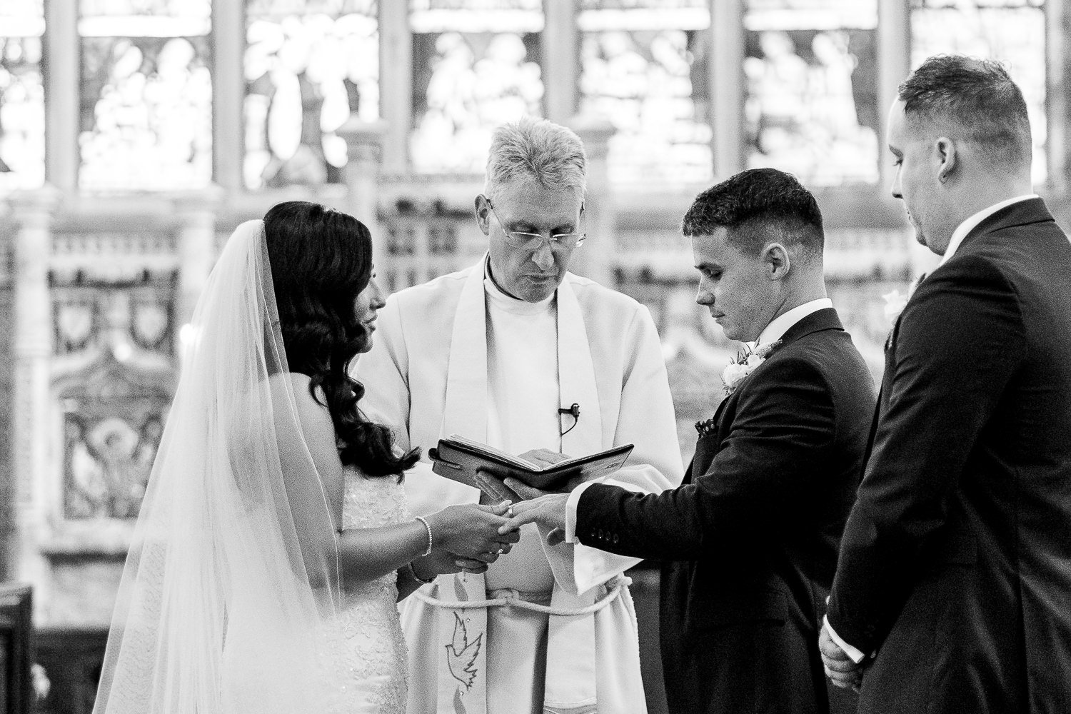 Bride and groom exchanging rings at St Martins.