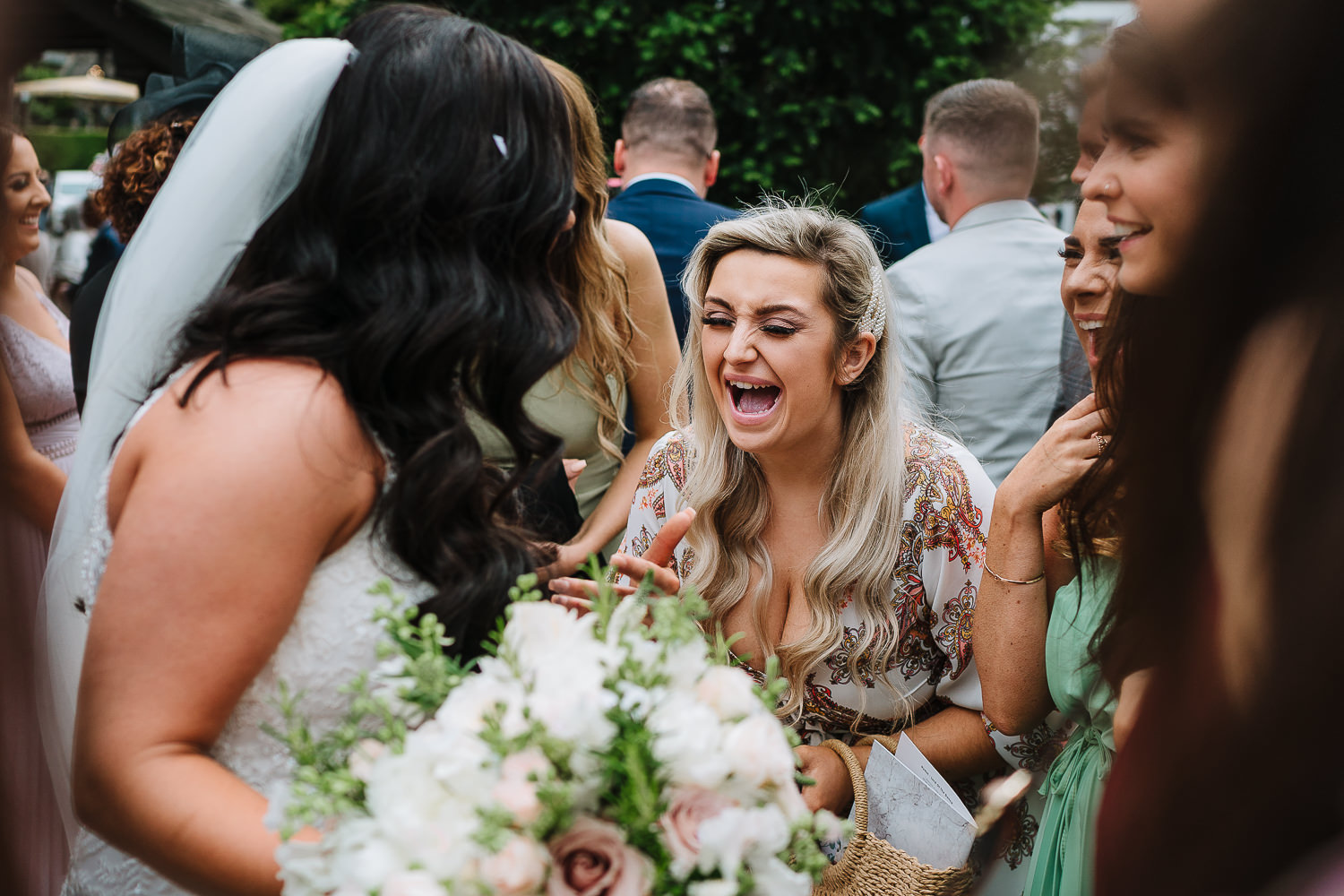 Guest laughing with the bride