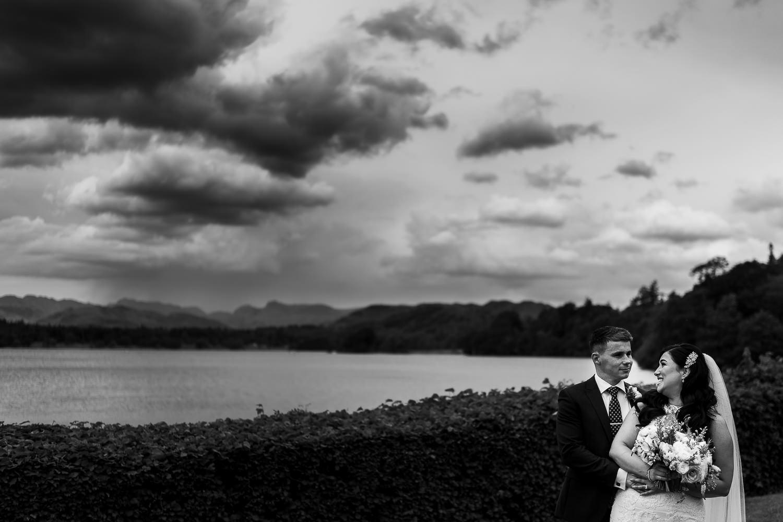 bride and groom cuddling at Low wood bay