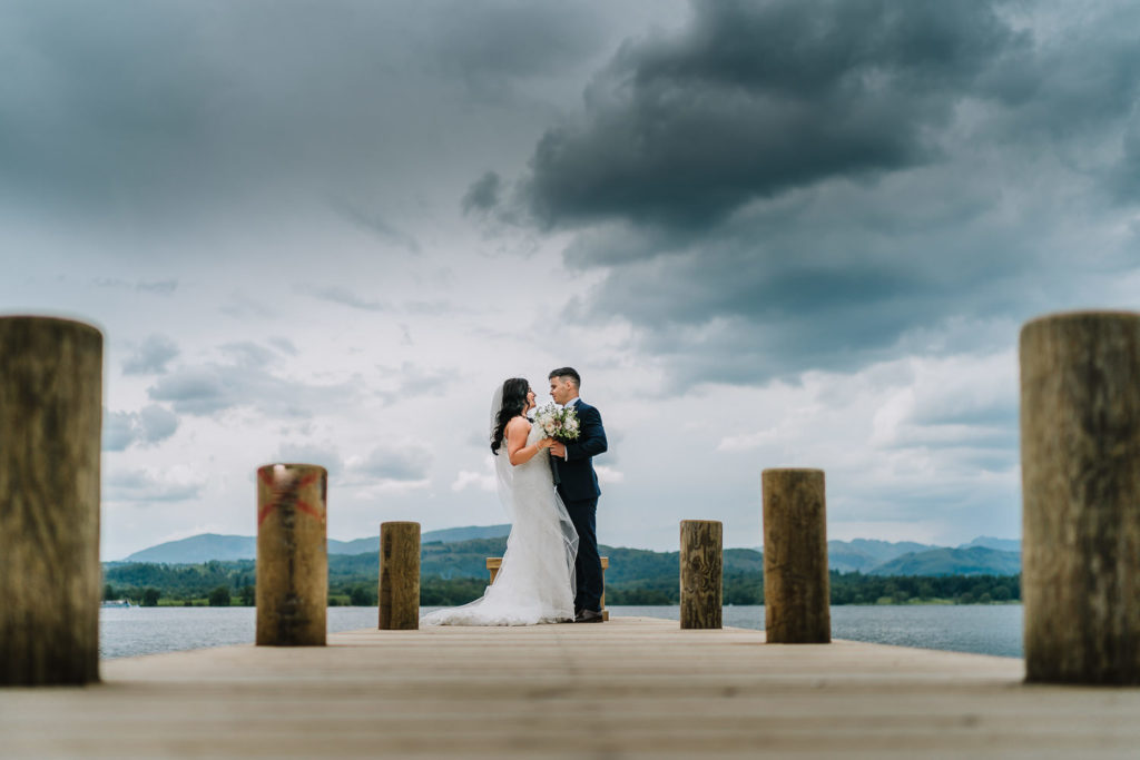 bride and groom on the jetty at Low Wood bay