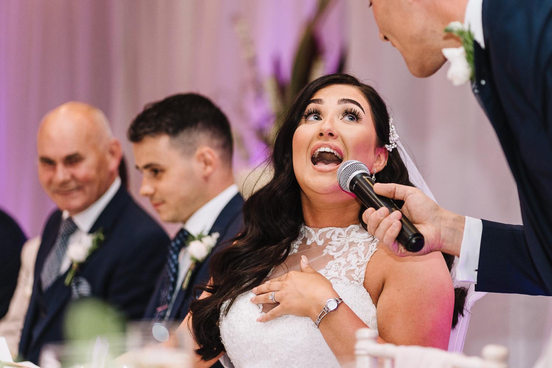 Bride singing during speeches
