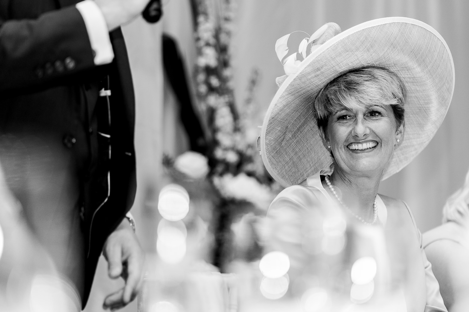 Mother of bride laughing during speeches