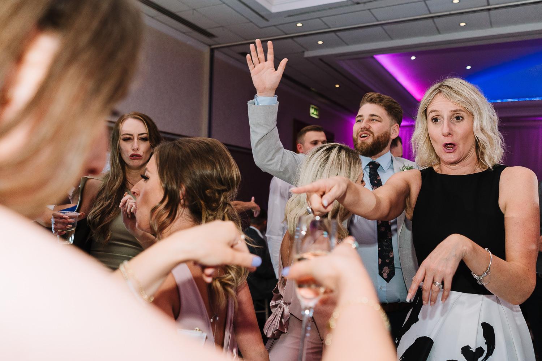 female guests dancing