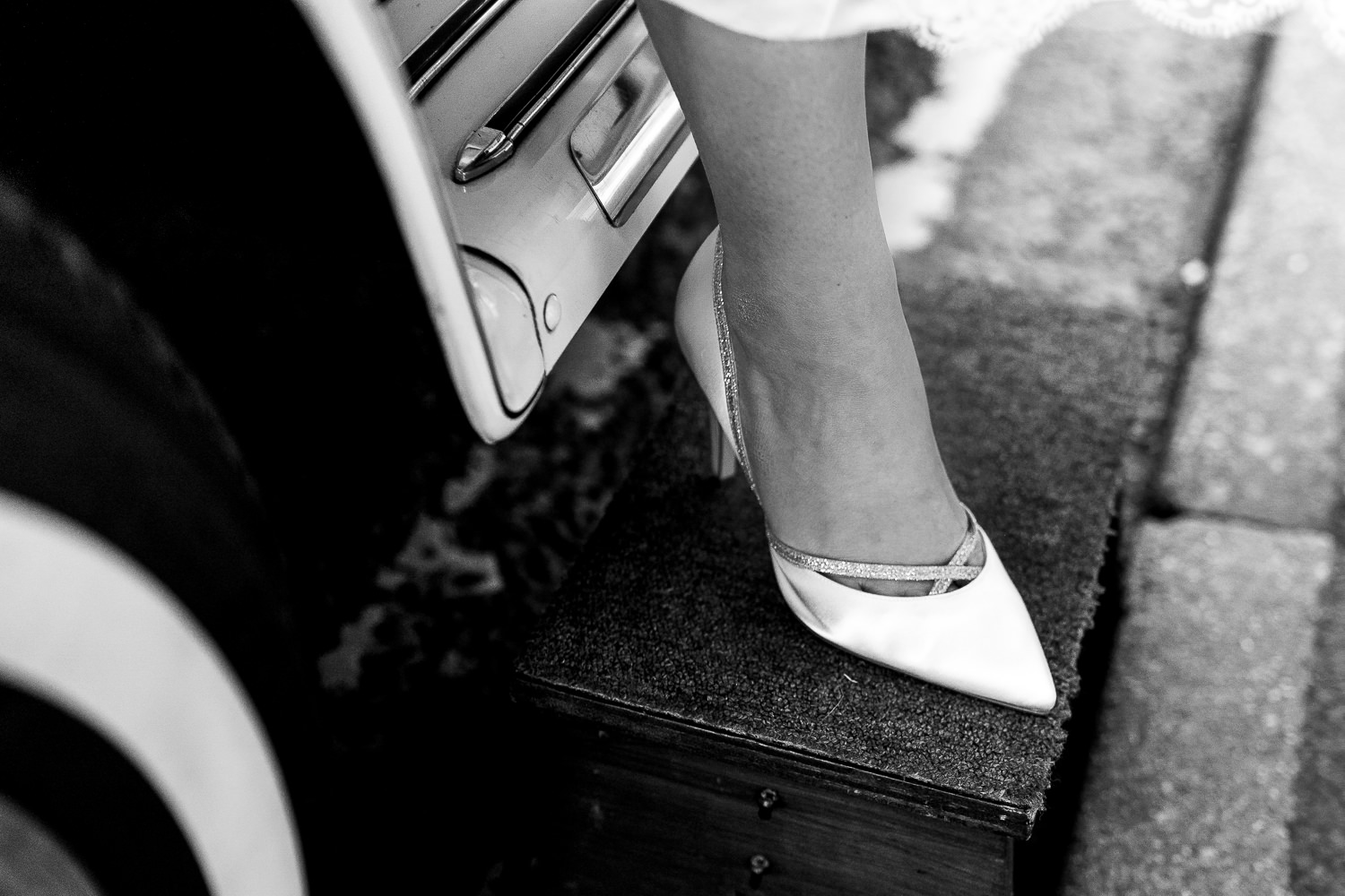 Brides shoe as she gets out of the car