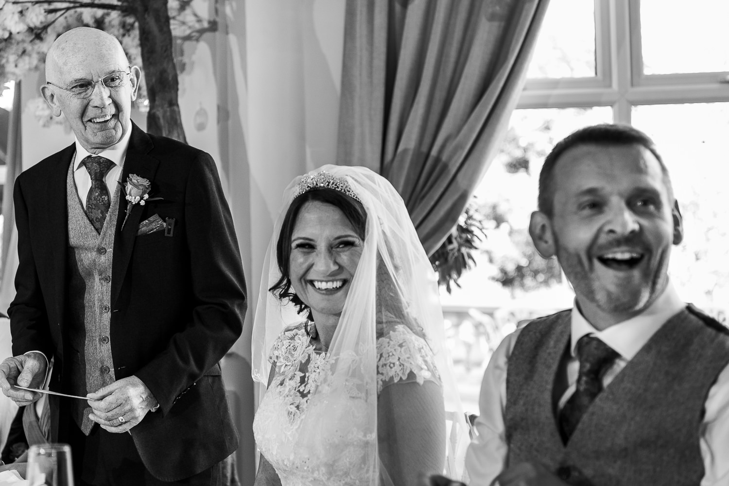 Father of the bride speech at Ashfield House with the bride and groom laughing