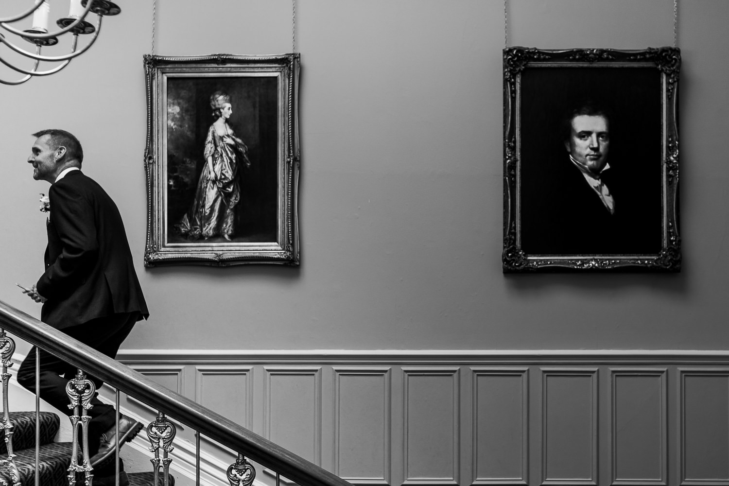 Groom walking up the stairs at Ashfield House