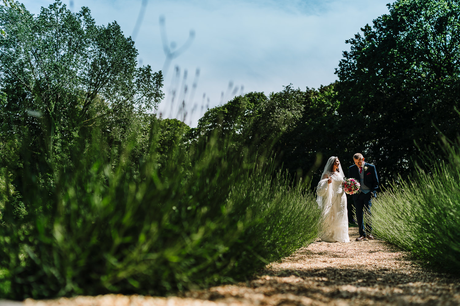 Bride and groom walking at Ashfield House