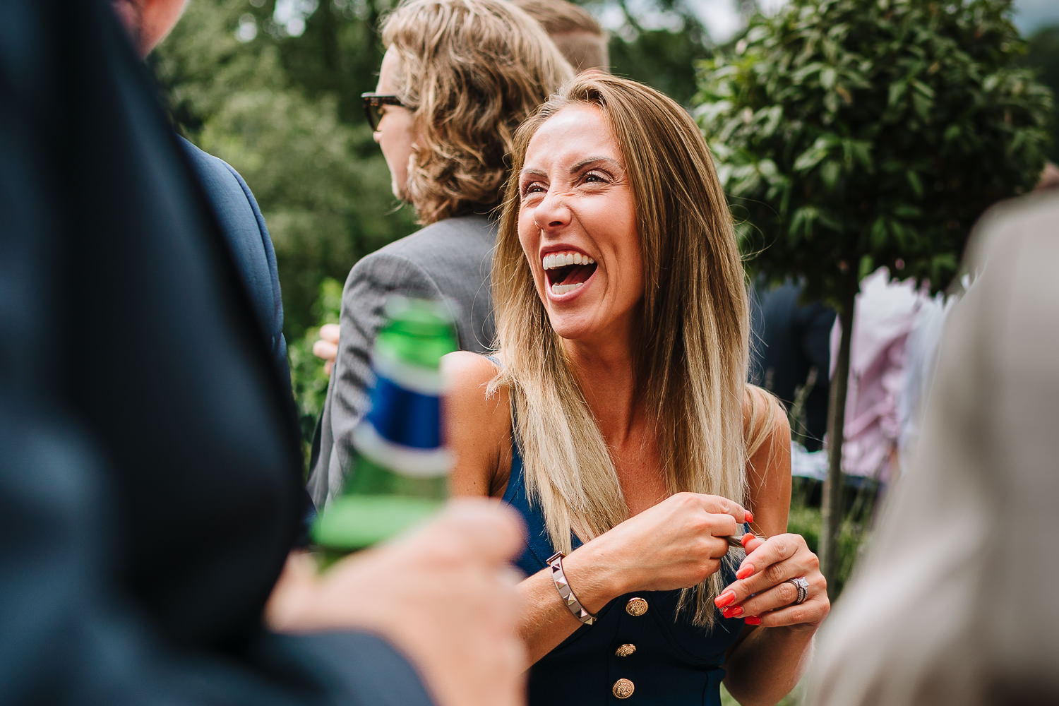 Wedding guest laughing at Mitton Hall