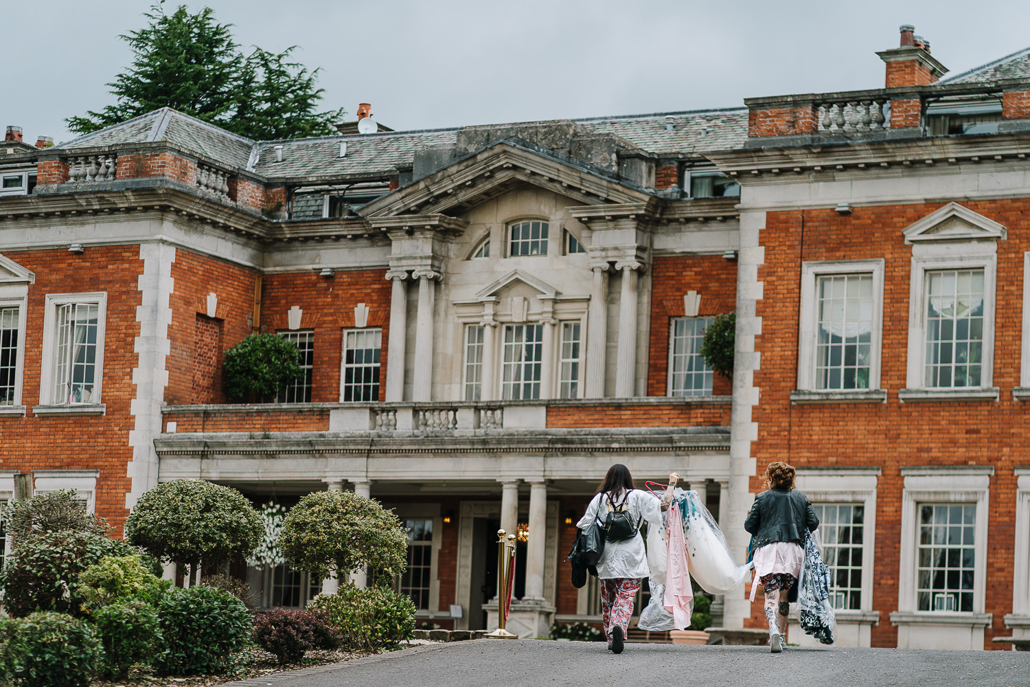 bride walking into eaves hall from the lodge