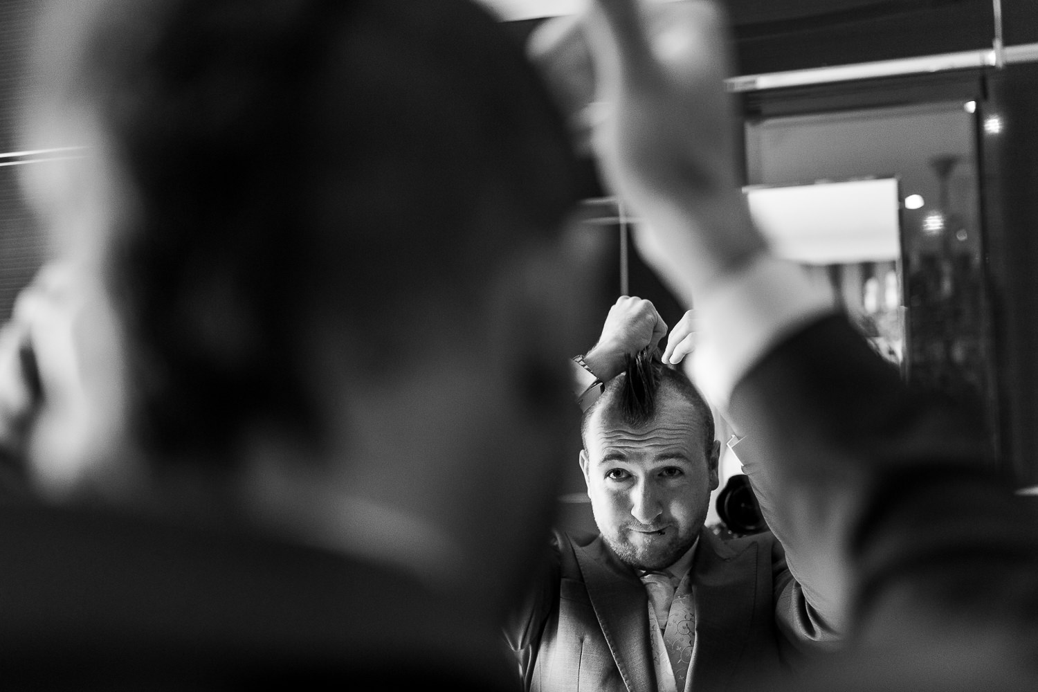 groom doing his hair