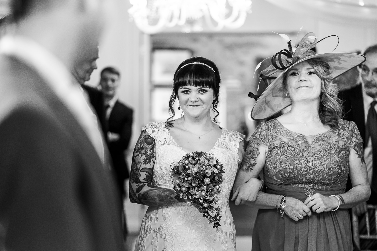 bride and her mum walking down the aisle
