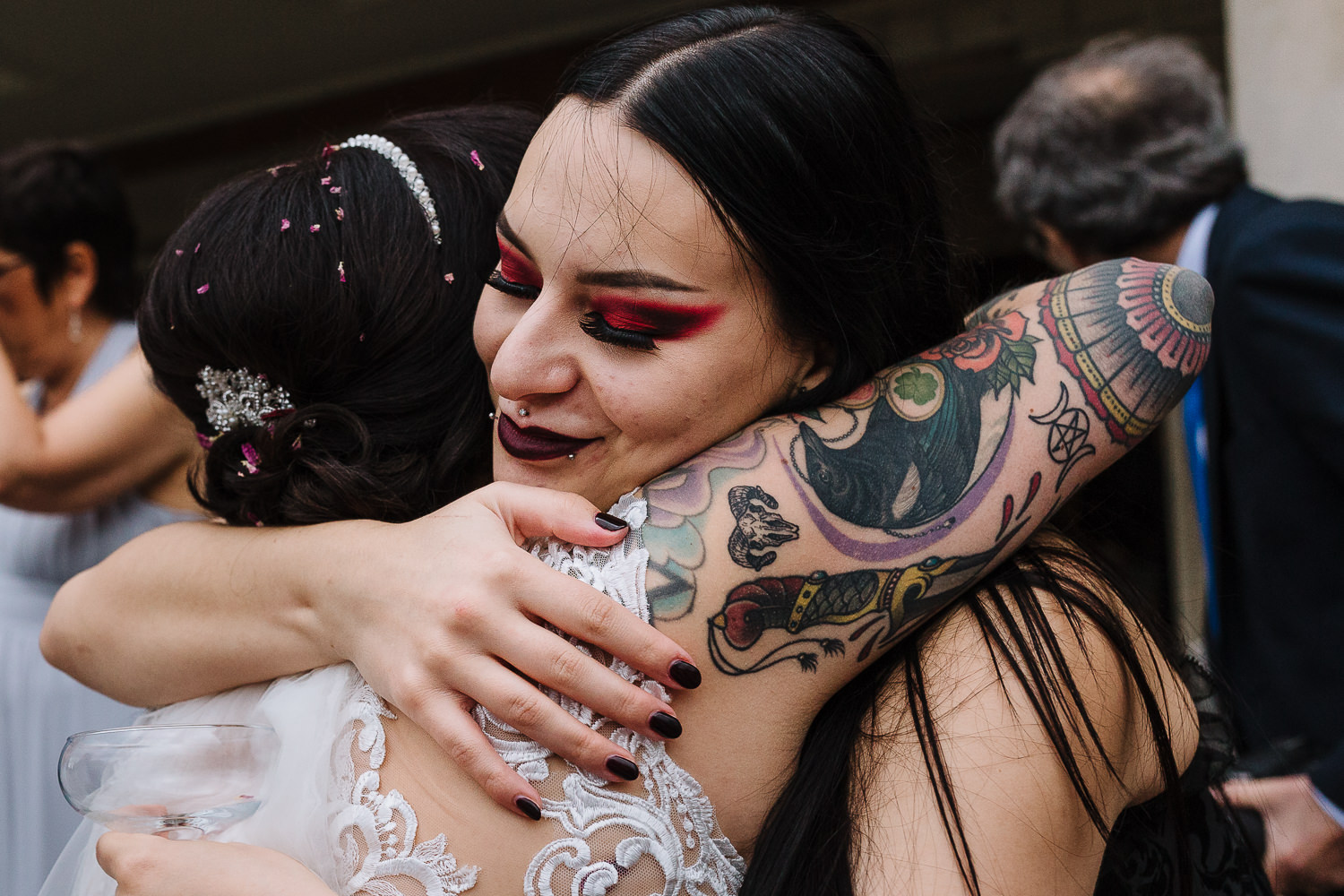bride hugging a female guest