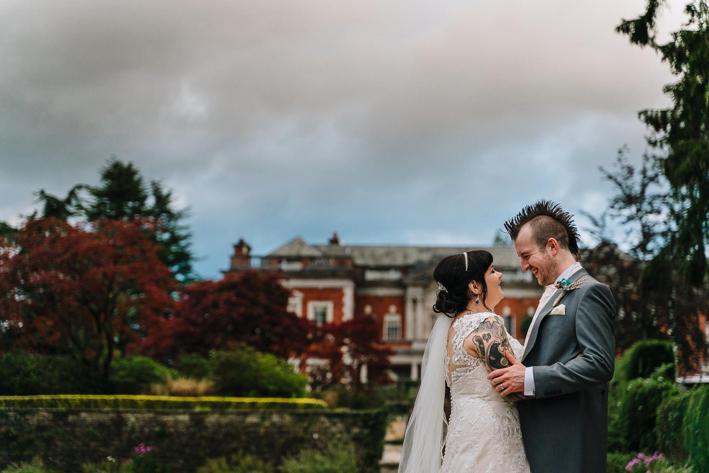 Bride and groom cuddling at Eaves Hall
