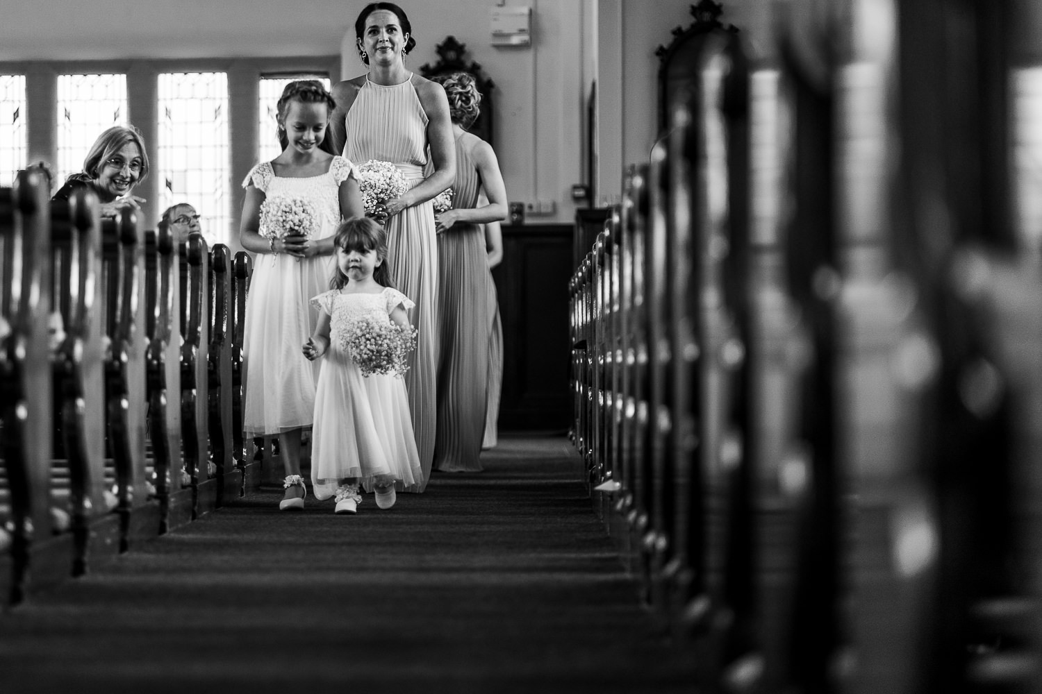 Flower girls walking into church