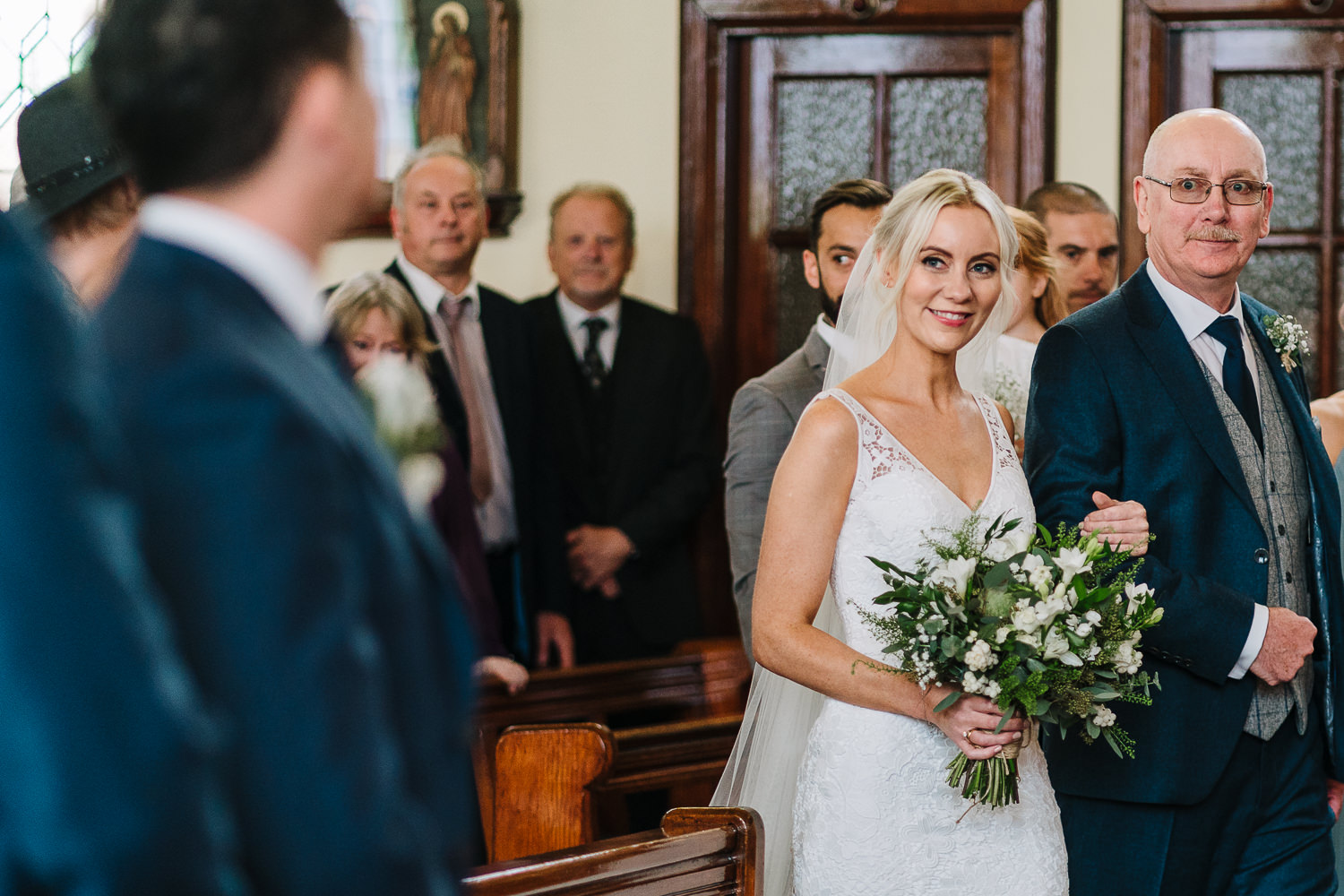 Bride walking in with her da