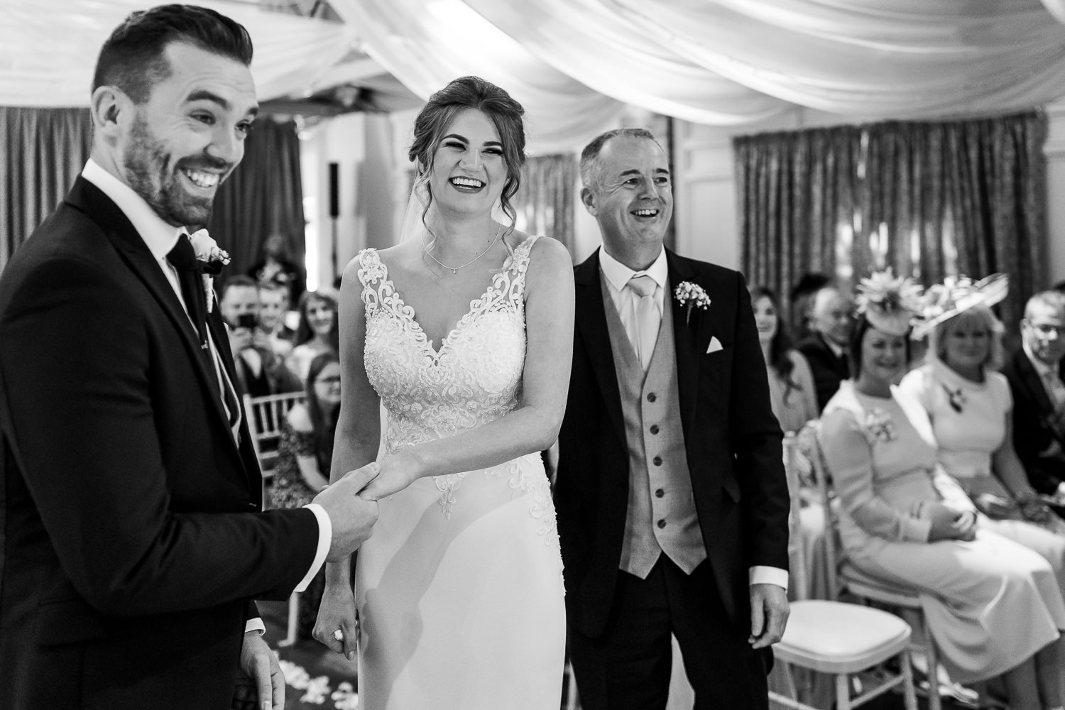 bride groom and her dad laughing