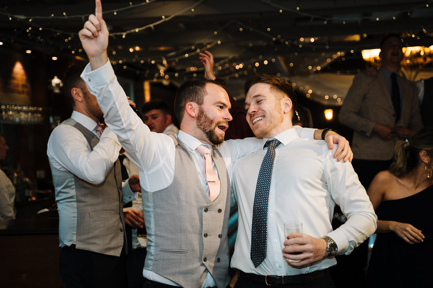 best man and guest dancing