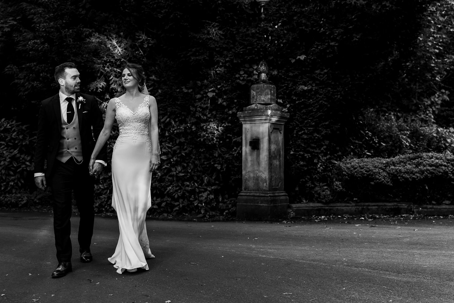 Bride and groom walking at Bartle Hall