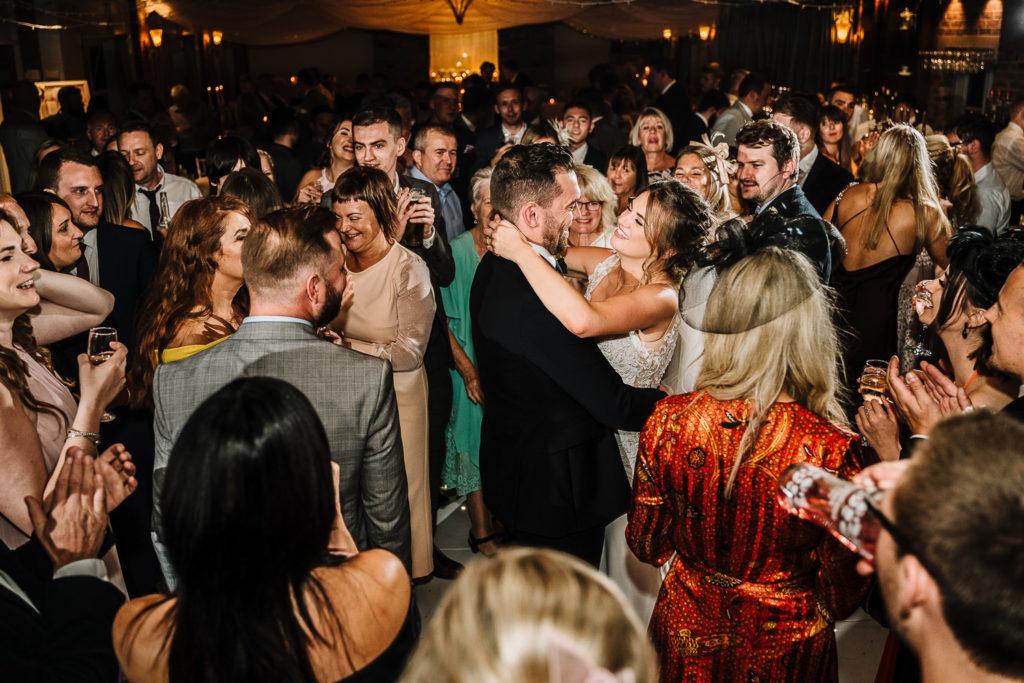 Dancefloor with bride and groom in the middle of the dance floor