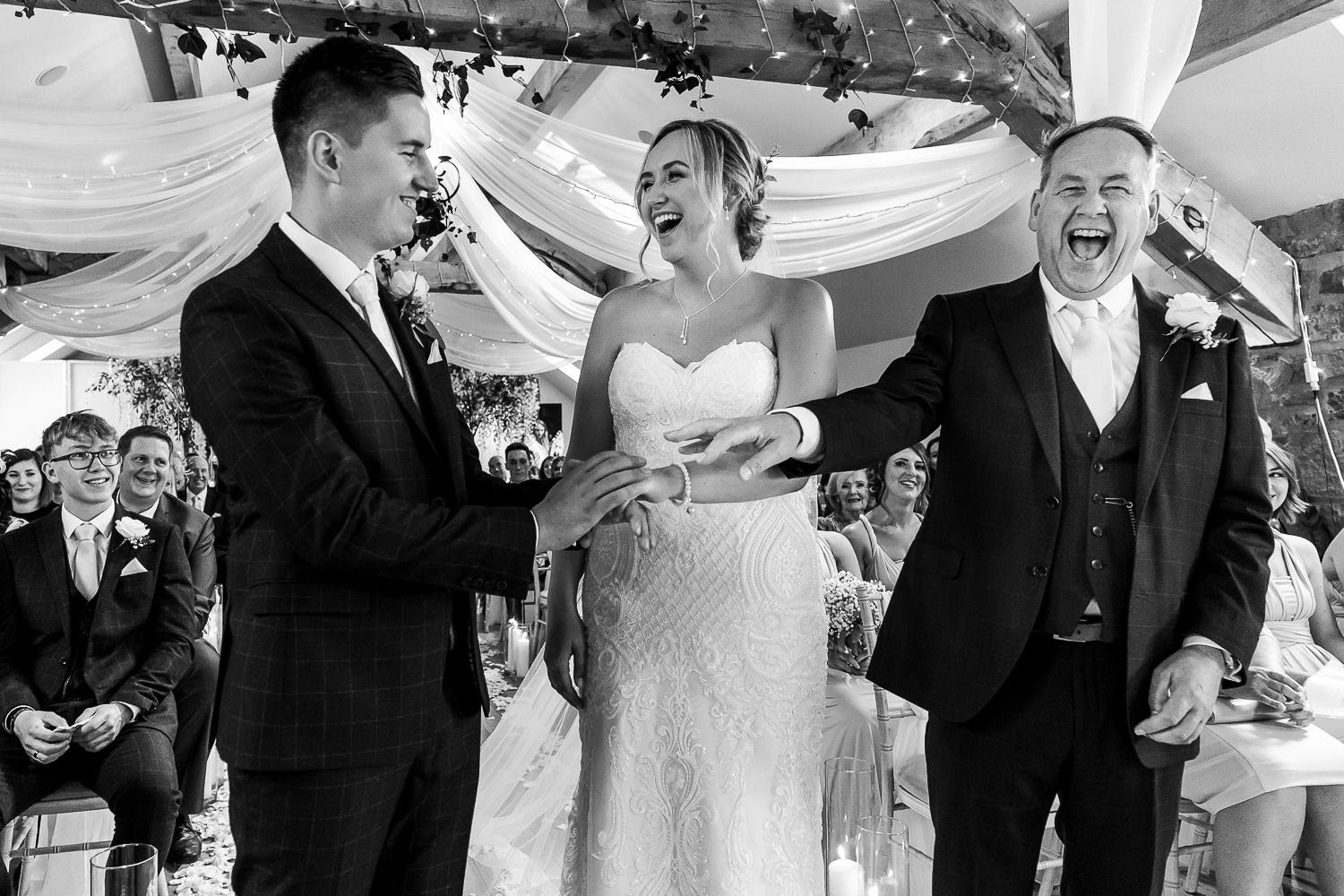 Groom bride and father of bride laughing