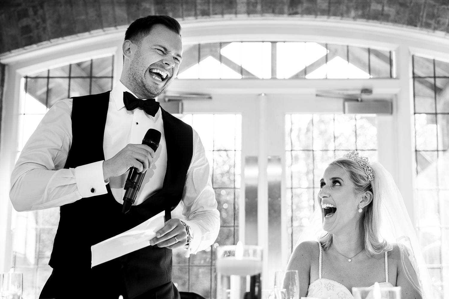 Bride and groom laughing during grooms speech at Colshaw Hall