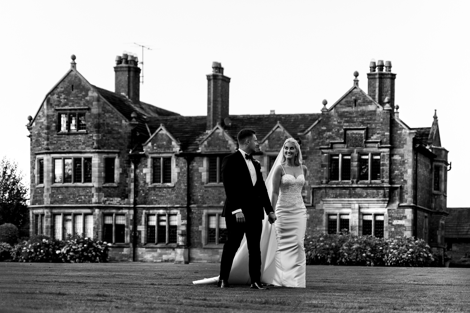 Bride and groom walking outside Colshaw Hall