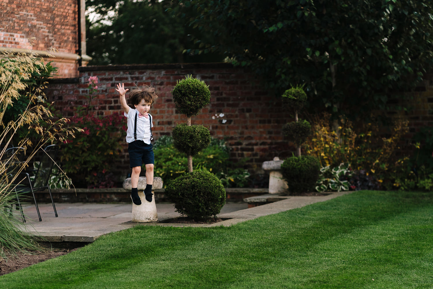 Little page boy jumping off a table at Colshaw Hall