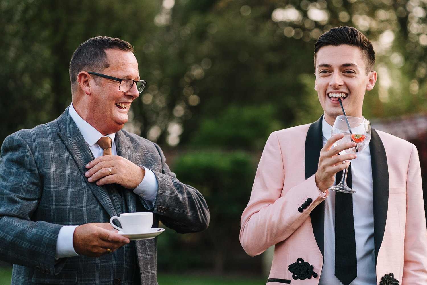 Two guests laughing and drinking
