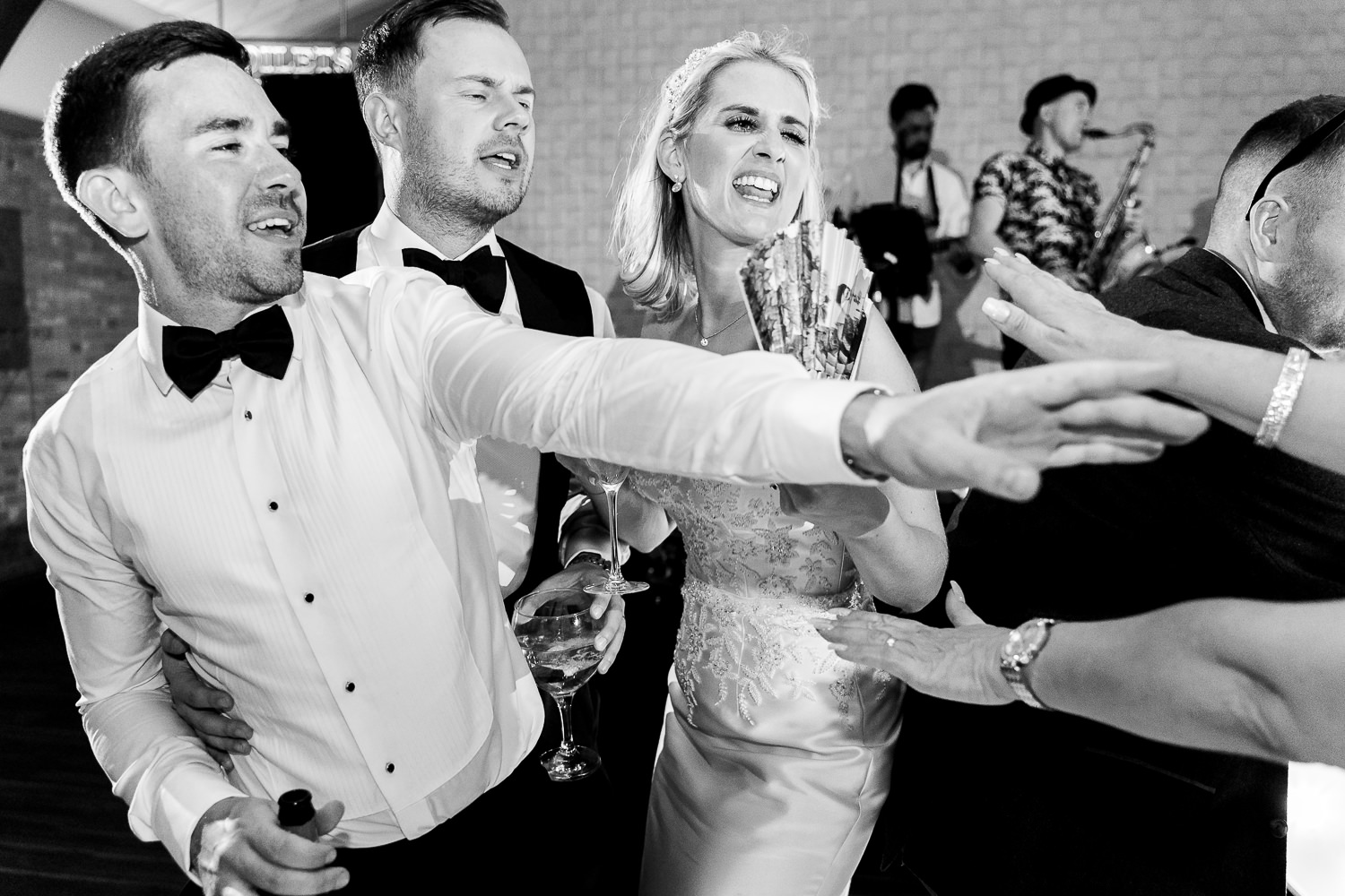 Bride dancing with groomsmen