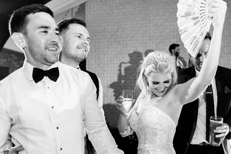 Bride dancing with a fan