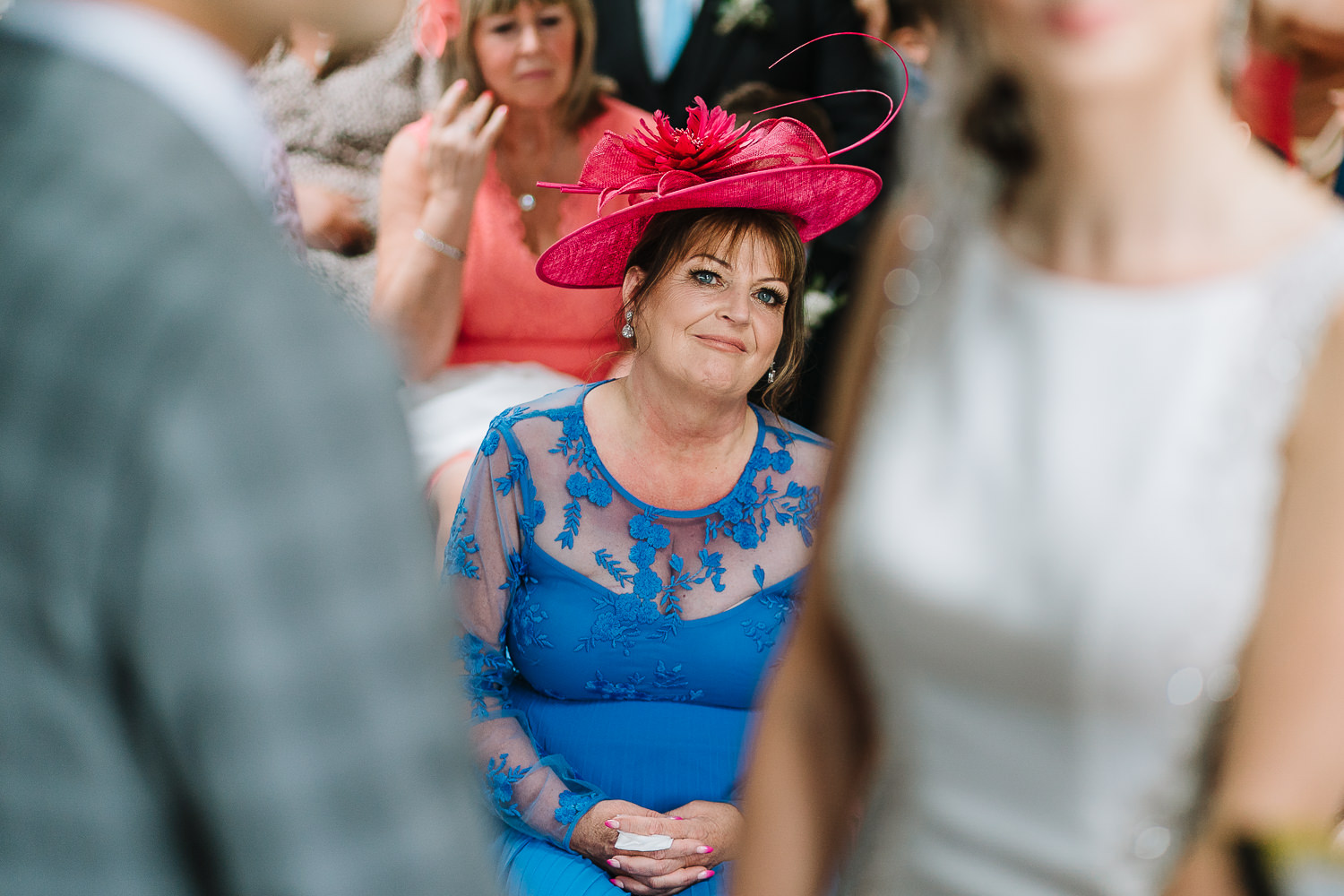 Mum looking on at the couple