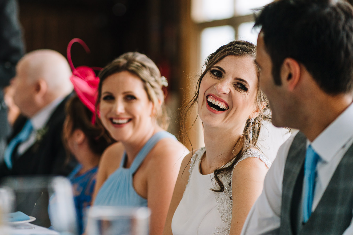 Bride laughing at Grange Barn