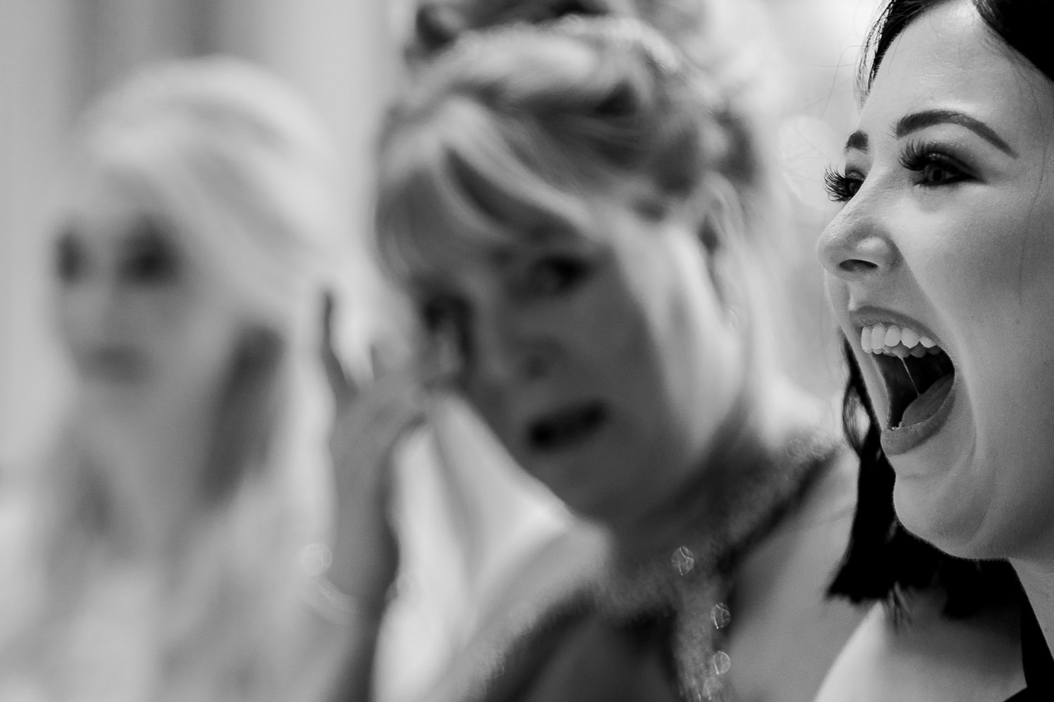 brides sister laughing and her mum crying
