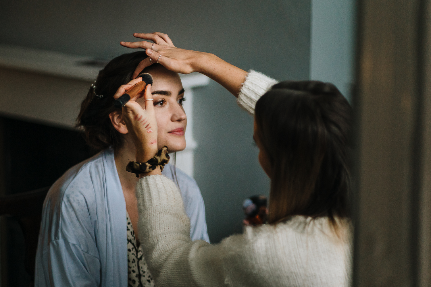 Bride having her make up done before the wedding at the Barbour Institute