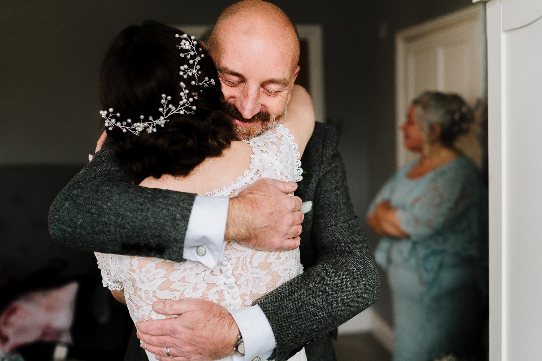 bride hugging her dad