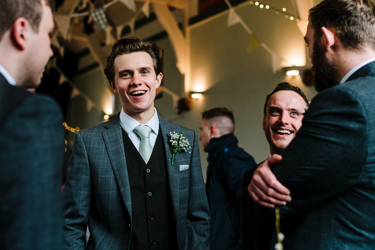 Groomsmen laughing before the ceremony