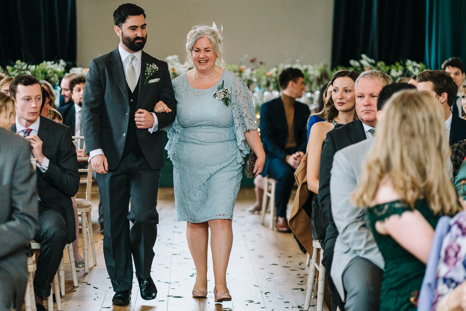 mother of bride walking down the aisle