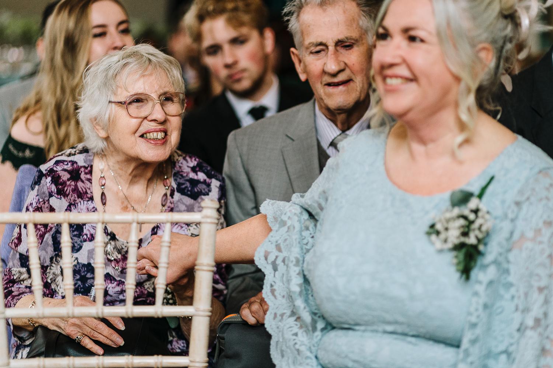 mother of bride hugging her mum