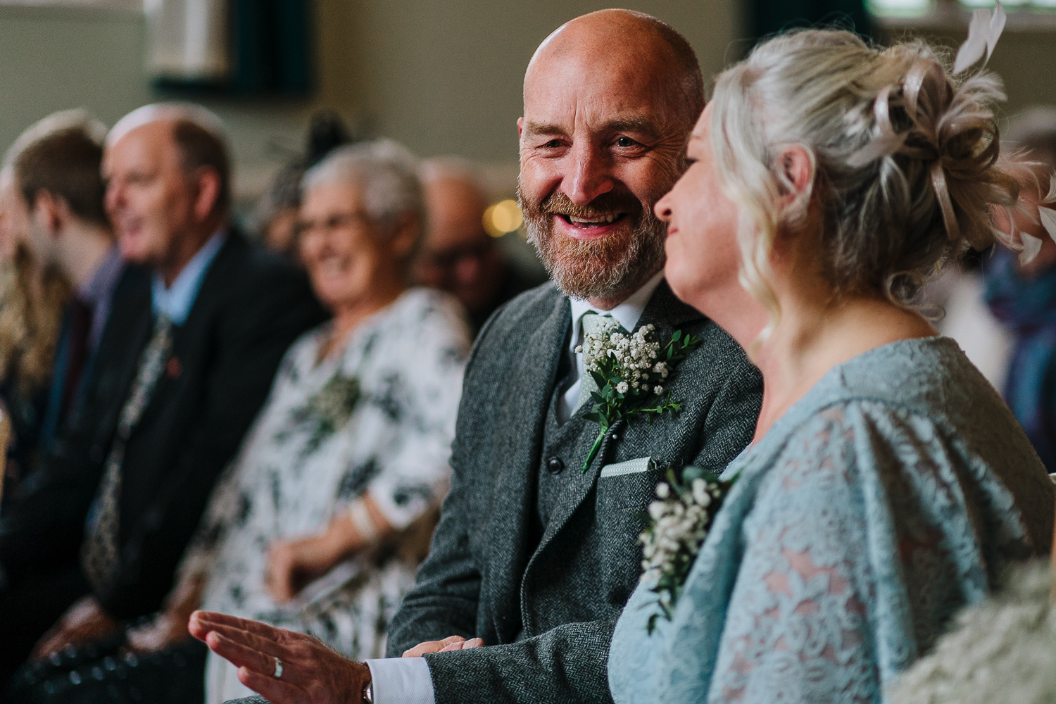 Brides parents laughing together