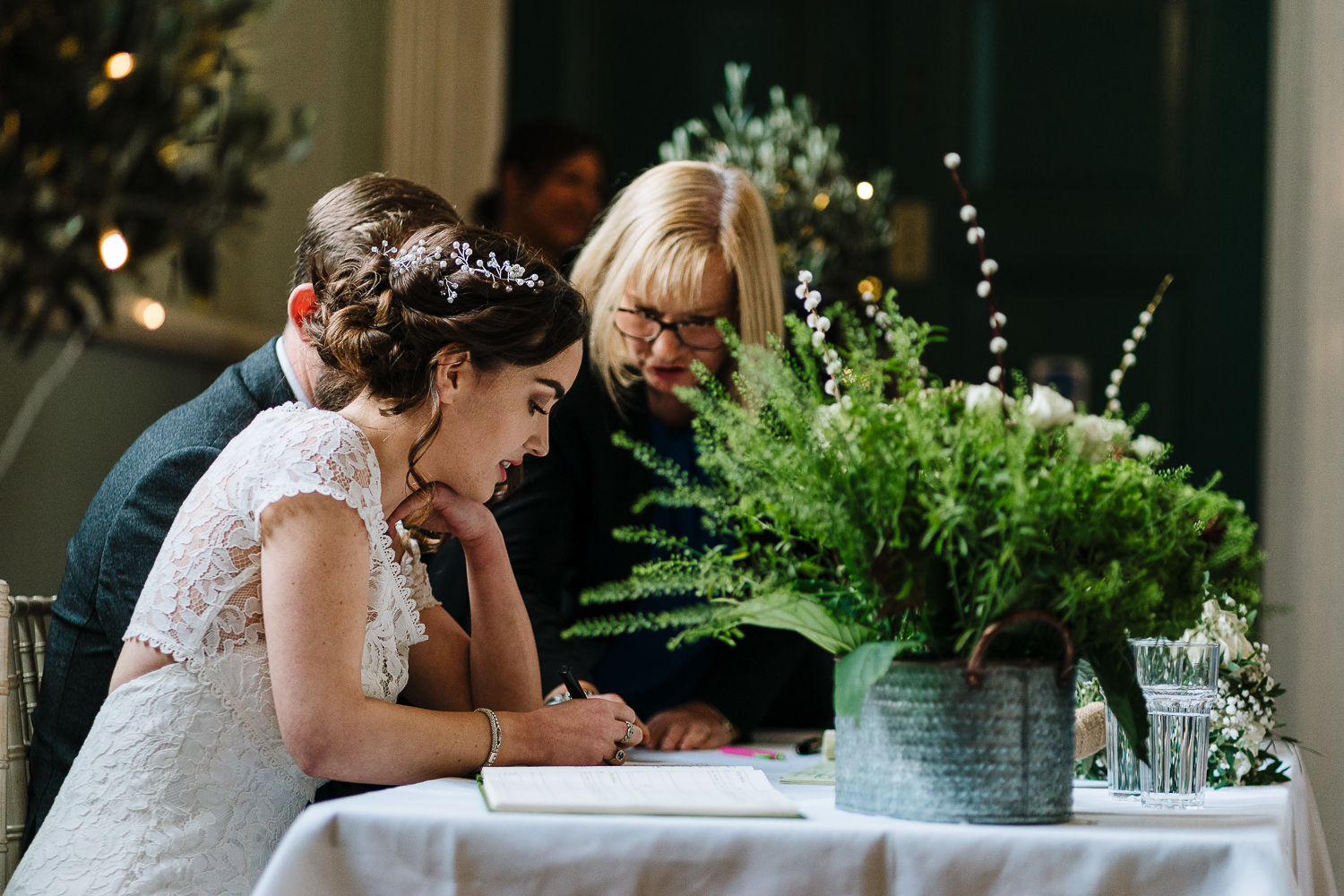 Bride signing the register at the Barbour Institute