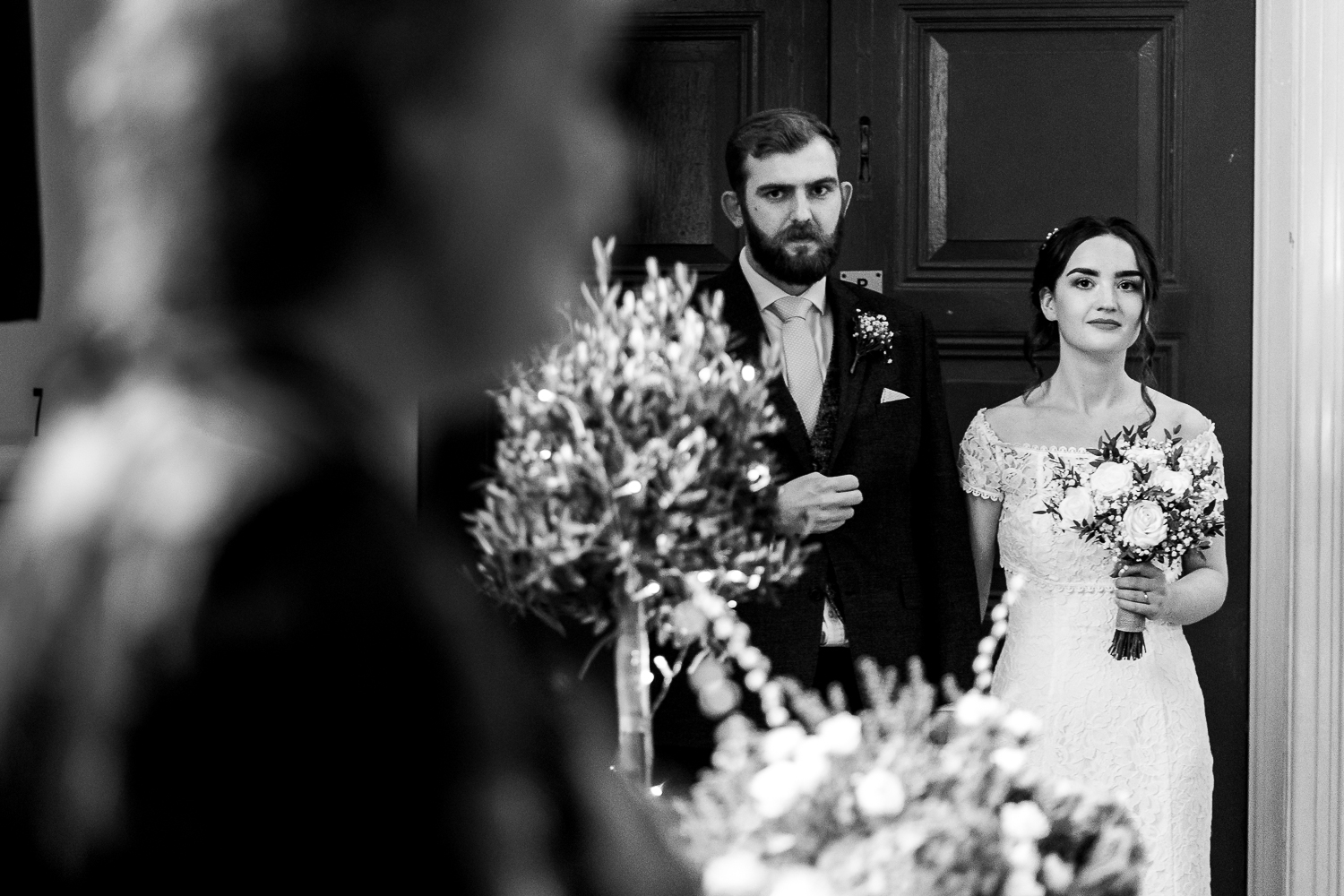 Bride and groom looking on at an opera singer