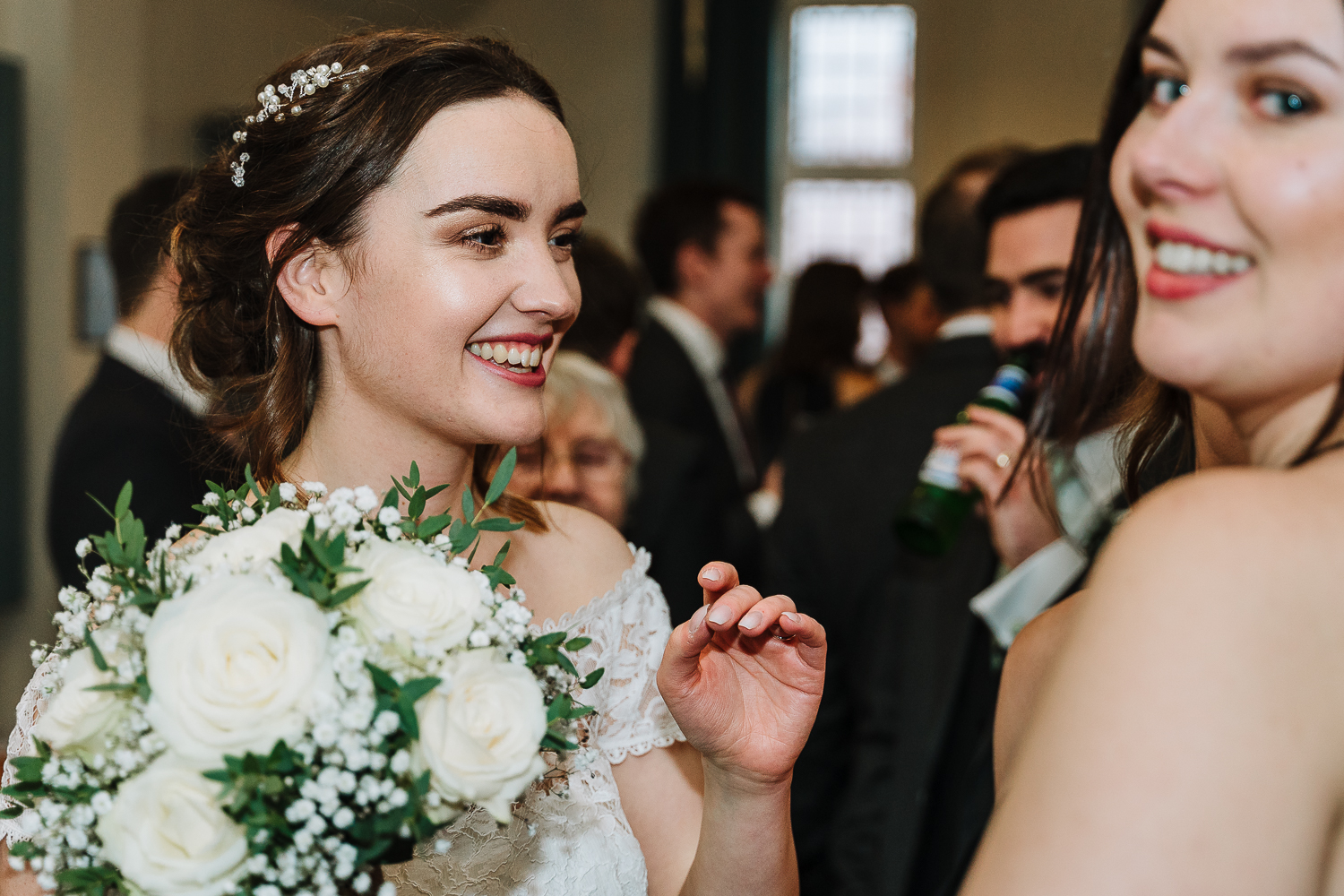 Bride smiling with guest