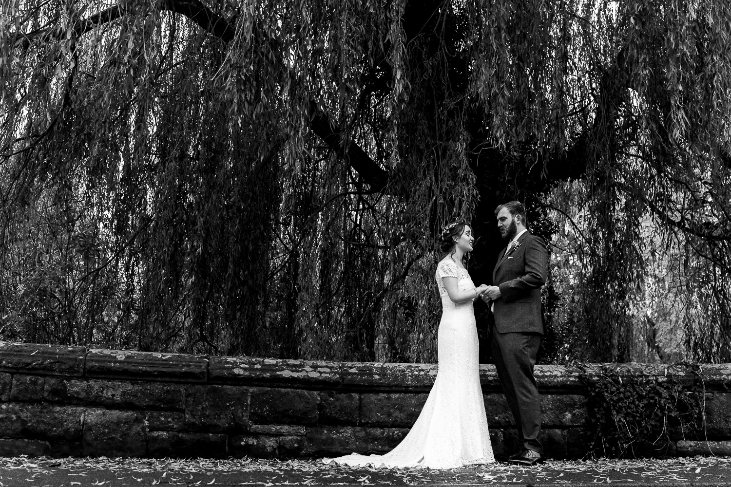 Bride and groom smiling in Tattenhall